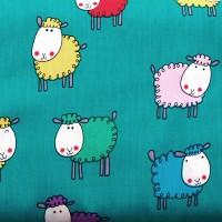 Tissu moutons multicolores sur fond vert caraïbes (x 50cm)