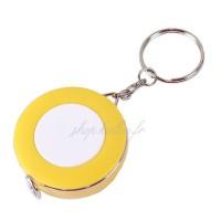 Mètre ruban, enrouleur automatique, porte-clef, coloris jaune